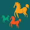 drei bunte Pferde auf grünem Hintergrund