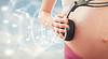 Konzept der Schwangerschaft und Musik. Bauch der schwangeren woma | Stock Photo