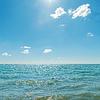 Blauer Himmel mit Sonne über Meer | Stock Foto
