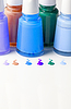 Butelki z rozlanej paznokci | Stock Foto