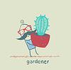 Gärtner führt Kaktus
