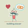 Hochzeitsplaner hält Ball in Form von Herzen und