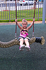 Beautiful girl play outdoor on swing | Stock Foto
