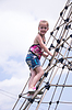 Girl climbing on rope ladder against sky | Stock Foto