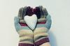 Snow heart in hands | 免版税照片