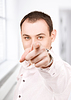 商人指着他的手指 | 免版税照片