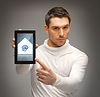 ID 3930188 | Man pointing at tablet pc with email icon | Foto stockowe wysokiej rozdzielczości | KLIPARTO