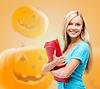 ID 4518156 | Smiling student girl with books and tablet bag | Foto stockowe wysokiej rozdzielczości | KLIPARTO