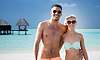 Happy couple in swimwear hugging on summer beach | Stock Foto