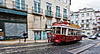 Photo 300 DPI: Tram 28 passing through Lisbon streets