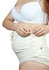 ID 3988188 | Schwangere Frau putzt Mutterschaft Gürtel | Foto mit hoher Auflösung | CLIPARTO