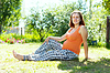 Pregnancy woman in summer meadow | Stock Foto