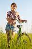 자전거와 여자 | Stock Foto