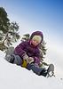 Dziecko przesuwając na śniegu | Stock Foto