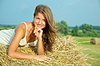 Young woman on hay bail | Stock Foto