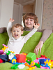 Happy mother plays with child | Stock Foto