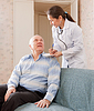 Doctor talks with senior patient | Stock Foto