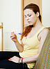 Unhappy serious woman with pregnancy test | Stock Foto