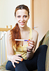 Happy girl with pregnancy test | Stock Foto
