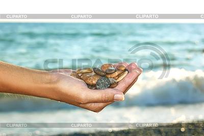 Marine pebbles in female hand | Foto stockowe wysokiej rozdzielczości |ID 3971941