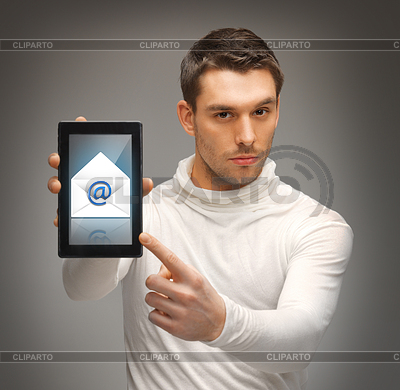 Man pointing at tablet pc with email icon | Foto stockowe wysokiej rozdzielczości |ID 3930188