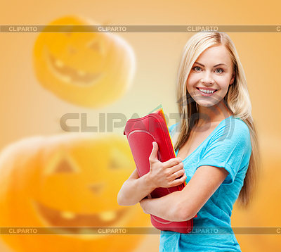 Smiling student girl with books and tablet bag | Foto stockowe wysokiej rozdzielczości |ID 4518156