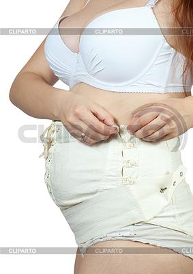 Schwangere Frau putzt Mutterschaft Gürtel | Foto mit hoher Auflösung |ID 3988188