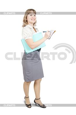 Weibliche Führungskraft auf Notizbuch | Foto mit hoher Auflösung |ID 4002978