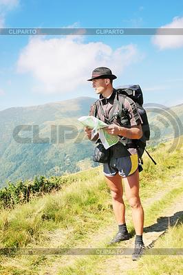 Man holds map | Foto stockowe wysokiej rozdzielczości |ID 4044375